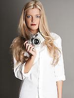 Pretty blonde girl holding camera