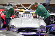 UNITED KINGDOM, London: 24 April 2018 A 1988 Ostermeier 'Gullwing' gets a final polish by members of Coys auctioneers. The car forms part of the Spring Classics: An Important Auction of Fine Historic Automobiles at The Royal Horticultural Halls, Westminster. The auction will see a collection of privately owned cars be auctioned this evening April 24th 2018. Rick Findler  / Story Picture Agency