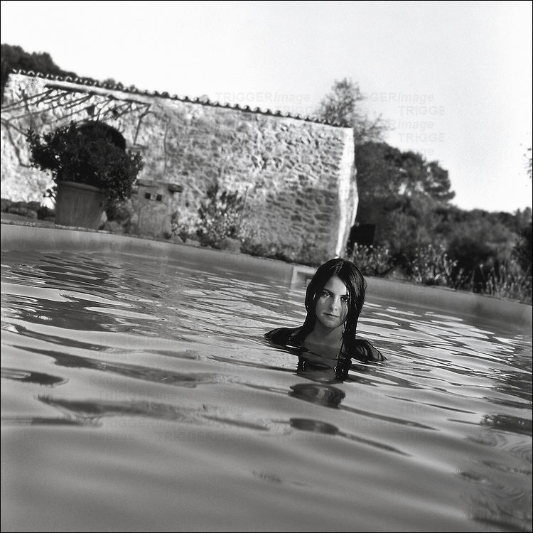 A young woman relaxing in a pool