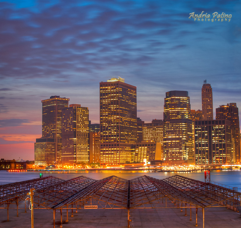 Lower Manhattan skyline at sunset with steel structure in the Brooklyn waterfront