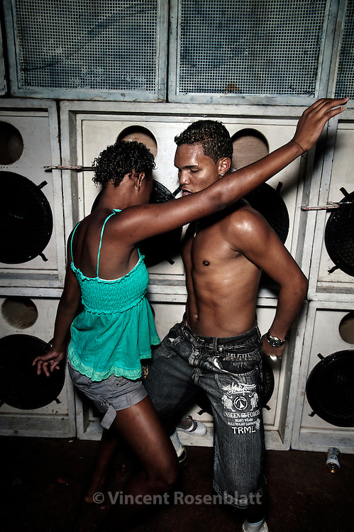 Dancing together. Baile Funk at Clube Paranhos, in the borough of Olaria, near the Complexo do Alemão favelas.