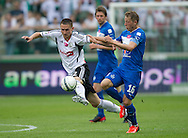 (L) Legia's Artur Jedrzejczyk  fights for the ball with (R) Lech's Rafal Murawski during T-Mobile Extraleague soccer match between Legia Warsaw and Lech Poznan at Pepsi Arena in Warsaw, Poland...Poland, Warsaw, May 18, 2013..Picture also available in RAW (NEF) or TIFF format on special request...For editorial use only. Any commercial or promotional use requires permission...Photo by © Adam Nurkiewicz / Mediasport