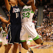 Jewell Loyd, Notre Dame, shoots over Bria Hartley, Connecticut, during the Connecticut V Notre Dame Final match won by Notre Dame during the Big East Conference, 2013 Women's Basketball Championships at the XL Center, Hartford, Connecticut, USA. 11th March. Photo Tim Clayton