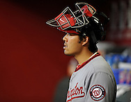 Aug. 10, 2012; Phoenix, AZ, USA; Washington Nationals catcher Kurt Suzuki (24) sits in the dugout prior to the game against the Arizona Diamondbacks at Chase Field.  Mandatory Credit: Jennifer Stewart-US PRESSWIRE