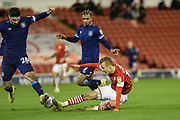 Marcel Ritzmaier of Barnsley FC competes for the ball with Huddersfield Town captain Christopher Schindler during the EFL Sky Bet Championship match between Barnsley and Huddersfield Town at Oakwell, Barnsley, England on 11 January 2020.