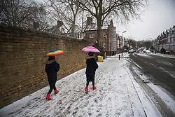 © Licensed to London News Pictures. 01/03/2018. London, UK. Orthodox Jewish children in fancy dress, carrying umbrellas, celebrate the festival of Purim on the streets of Stamford Hill in north London on March 1, 2018. Purim celebrates the miraculous salvation of the Jews from a genocidal plot in ancient Persia, an event documented in the Book of Esther. Traditionally the jewish community wear fancy dress and exchange reciprocal gifts of food and drink. Photo credit: Ben Cawthra/LNP
