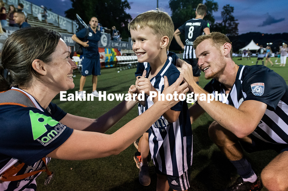 Twins Jack and Ben Balentine (6) get their jerseys signed after the game. The Men's Asheville City Soccer Club lost New Orleans Jesters to 3-1  in Memorial Stadium in Asheville, NC on June 29, 2018.