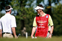 Pro Caddie, Ted Scott, shares a light moment with PGA rookie, Bubba Watson, during  the first day of the Pro Am that was held at Forest Oaks golf club in Greensboro, NC Monday October 2, 2006. Scott has been a caddie for six years but has only been with Watson for three weeks.&amp;#xD;Photo by David Duncan&amp;#xD;<br />