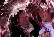 Puno Festival, Puno, on the shores of Lake Titicaca.Dancers wearing headdresses of Condor feathers. Peru