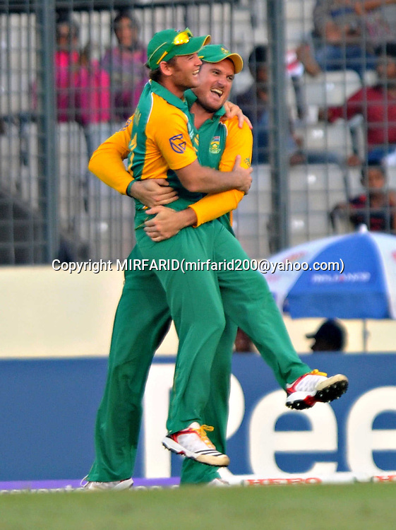 Jacques Kallis and Graeme Smith celebrate the wicket of Jesse Ryder during the ICC Cricket World Cup quarter final match between South Africa and New Zealand held at the Shere Bangla National Stadium, Mirpur, Bangladesh on the 25 March 2011..Photo by SPORTZPICS