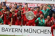 Bayern Munich's players and the team pose with the trophy after the German First division Bundesliga football match FC Bayern Munich v Eintracht Frankfurt in Munich, <br /> Arjen ROBBEN, Franck RIBERY,  RAFINHA, Sven ULREICH, Mats HUMMELS, David ALABA, 4 Niklas S&Uuml;LE, Suele,  6 Thiago Alc&aacute;ntara, Alcantara, 9 Robert Lewandowski, 18 Leon GORETZKA, 11, James RODRIGUEZ,  22 Serge GNABRY, 35 Renato SANCHES, 39 Ron-Thorben HOFFMANN, Keeper <br /> MUNICH, 18. MAY 2019,  Fc BAYERN vs Eintracht FRANKFURT, 5:1 - Bundesliga Football Match, <br /> FcBayern Muenchen vs Eintracht FRANKFURT Bundesliga match at Allianz Arena on 18.05.2019, DFL REGULATIONS PROHIBIT ANY USE OF PHOTOGRAPHS AS IMAGE SEQUENCES AND/OR QUASI-VIDEO - fee liable image, <br /> copyright &copy; ATP / Arthur THILL