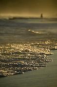 Summer afternoon beach walk in a  setting sun's golden light, East Coast Australia