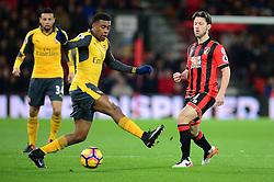 Harry Arter of Bournemouth passes the ball through Alex Iwobi of Arsenal legs. - Mandatory by-line: Alex James/JMP - 03/01/2017 - FOOTBALL - Vitality Stadium - Bournemouth, England - Bournemouth v Arsenal - Premier League