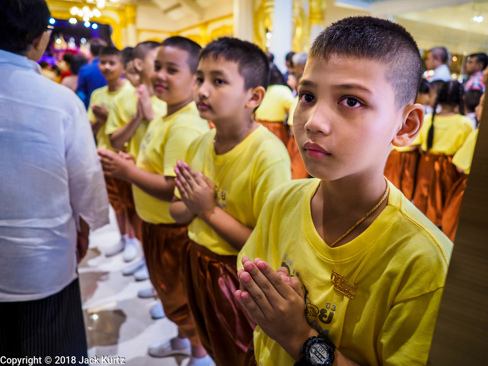 09 NOVEMBER 2018 - BANGKOK, THAILAND:  School children greet shoppers coming into ICONSIAM during the grand opening. ICONSIAM opened November 9. ICONSIAM is a mixed-use development on the Thonburi side of the Chao Phraya River. It includes two large malls, with more than 520,000 square meters of retail space, an amusement park, two residential towers and a riverside park. It is the first large scale high end development on the Thonburi side of the river and will feature the first Apple Store in Thailand and the first Takashimaya department store in Thailand.      PHOTO BY JACK KURTZ