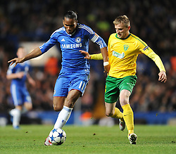 Chelsea`s Didier Drogba  battles with Zalina's Mario Pecalka  Chelsea vs MSK Zilina  for the  Uefa Champions Premier League, Group H,  at Stamford Bridge stadium in London on 23/11/2010. Picture By Rob Noyes  ©IPS   Photo Agency:21 Delisle Road  London SE28 0JD - Personal mobile: 07966 515 681