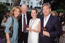 Left to right, LARA CAZALET, LORD ROTHSCHILD and CHARLIE BUTTER and his wife AGNIESZKA at the Tatler Summer Party, The Hempel Hotel, 31-35 Craven Hill Gardens, London W2 on 25th June 2008.<br />