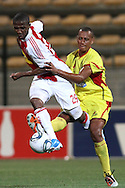CAPE TOWN, SOUTH AFRICA - 11 FEBRUARY 2011, Thembinkosi Fanteni of Ajax Cape Town wins possession from Wayne Arendse of Santos during the Absa Premiership match between Santos and Ajax Cape Town held at Athlone Stadium in Cape Town, South Africa..Photo by: Shaun Roy/Sportzpics