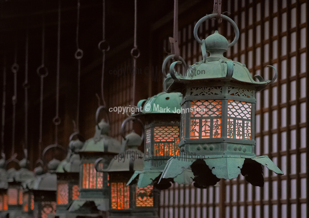 Nara was established as the first &quot;permanent&quot; capital of Japan in the year 710.<br /> <br /> The Fujiwara family had primacy in Nara during this period, and built the Kasuga Taisha shrine dedicated to the Shinto dieties that protected the new capital city.<br /> <br /> These lanterns at the shrine are lit only twice a year during special festival periods.  Here they glow in the early evening light during &quot;Setsubun&quot;, which falls in early February on the day before the first day of Spring on the lunar calendar.