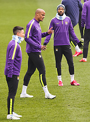 Manchester City's Vincent Kompany has a disagreement with Gael Clichy during the training session at the Etihad Campus ahead of the UEFA Champions League second leg match against FC Barcelona - Photo mandatory by-line: Matt McNulty/JMP - Mobile: 07966 386802 - 17/03/2015 - SPORT - Football - Manchester - Etihad Campus - Barcelona v Manchester City - UEFA Champions League