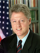 William Jefferson Clinton (born 1946) 42nd President of the United States from 1993-2001. Head-and-shoulders portrait with stars-and-stripes in background. American Politician Democrat