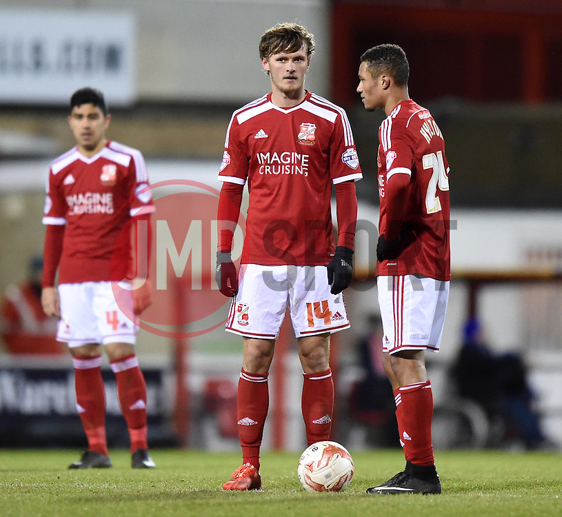 Swindon Town's John Swift and Jermaine Hylton prepare to resume play after Gillingham's third goal at the County Ground - Photo mandatory by-line: Paul Knight/JMP - Mobile: 07966 386802 - 03/03/2015 - SPORT - Football - Swindon - The County Ground - Swindon Town v Gillingham - Sky Bet League One