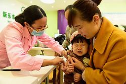 April 25, 2018 - Shijiazhuang, Shijiazhuang, China - Shijiazhuang, CHINA-25th April 2018: A baby receives vaccination at a disease control center in Shijiazhuang, north China's Hebei Province. (Credit Image: © SIPA Asia via ZUMA Wire)