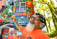 "Huntington, New York, U.S. 24th August 2013. INK76, street artist  ALEXANDER SILVA from Brooklyn, is pointing to the ""Art Matters"" wall, graffiti legendary street artist SONIC BAD and he painted on the back of the Huntington Arts Council building, during the the art event ""Off the Walls"" Block Party, by SPARKBOOM, a project the council created to help emerging artists, showcase talents, and help its artistic family network."