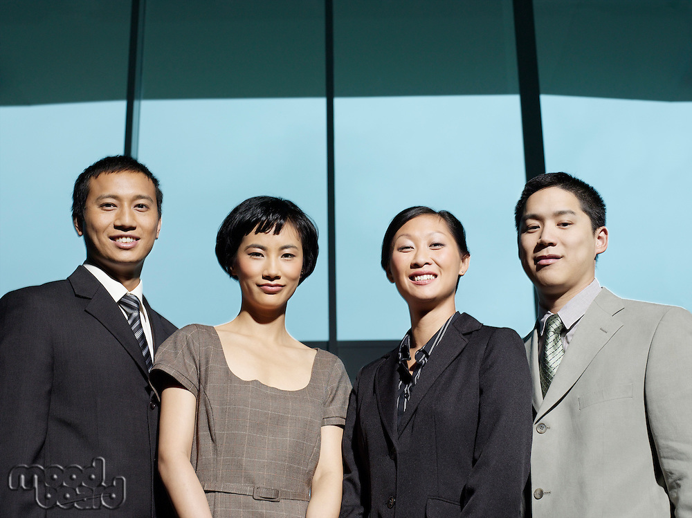 Confident Businesspeople group portrait low angle view