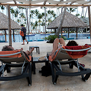 BAVARO, DOMINICAN REPUBLIC-DECEMBER 3, 2014: <br /> Tourist lounge in the pool area of the all inclusive Barcel&oacute; Premium Adults Only hotel in B&aacute;varo. Story on tourism to the Caribbean Island.  (Photo by Angel Valentin/Getty Images for Der Spiegel)