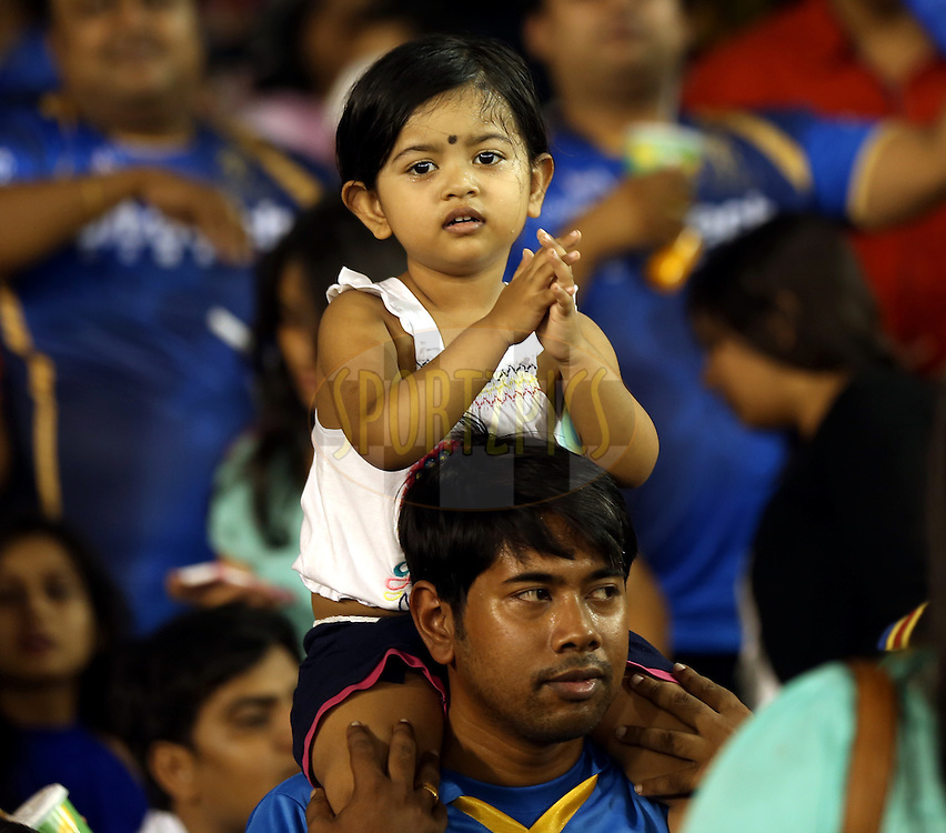 A kid enjoys during match 22 of the Pepsi IPL 2015 (Indian Premier League) between The Rajasthan Royals and The Royal Challengers Bangalore held at the Sardar Patel Stadium in Ahmedabad , India on the 24th April 2015.<br /> <br /> Photo by:  Sandeep Shetty / SPORTZPICS / IPL