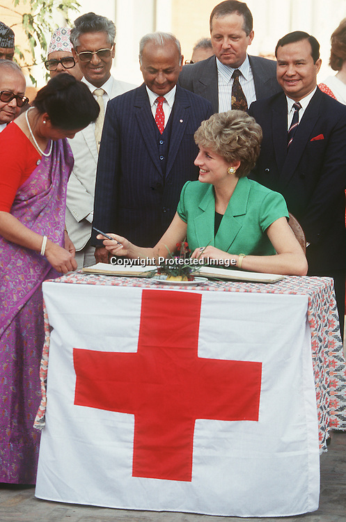 Diana, Princess of Wales, visits a Red Cross centre in Nepal in 1985.  Her sons, Prince William and Prince Harry also showed their appreciation of the work of the Red Cross by helping send aid parcels to the tsunami victims from Bristol on January 7, 2005.<br /> NEPAL - 1985