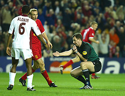 LIVERPOOL, ENGLAND - Tuesday, March 19, 2002: Referee Rune Pedersen points to the spot to give Liverpool a penalty during the UEFA Champions League Group B match against AS Roma at Anfield. (Pic by David Rawcliffe/Propaganda)