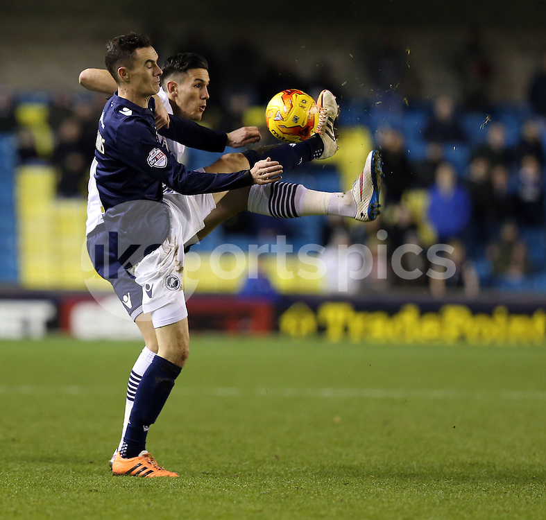 Bolton's Connor Wilkinson and Millwall's Shaun Williams during the Sky Bet Championship match between Millwall and Bolton Wanderers at The Den, London, England on 19 December 2014. Photo by Dave Peters.