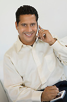 Businessman With PDA and Cell Phone