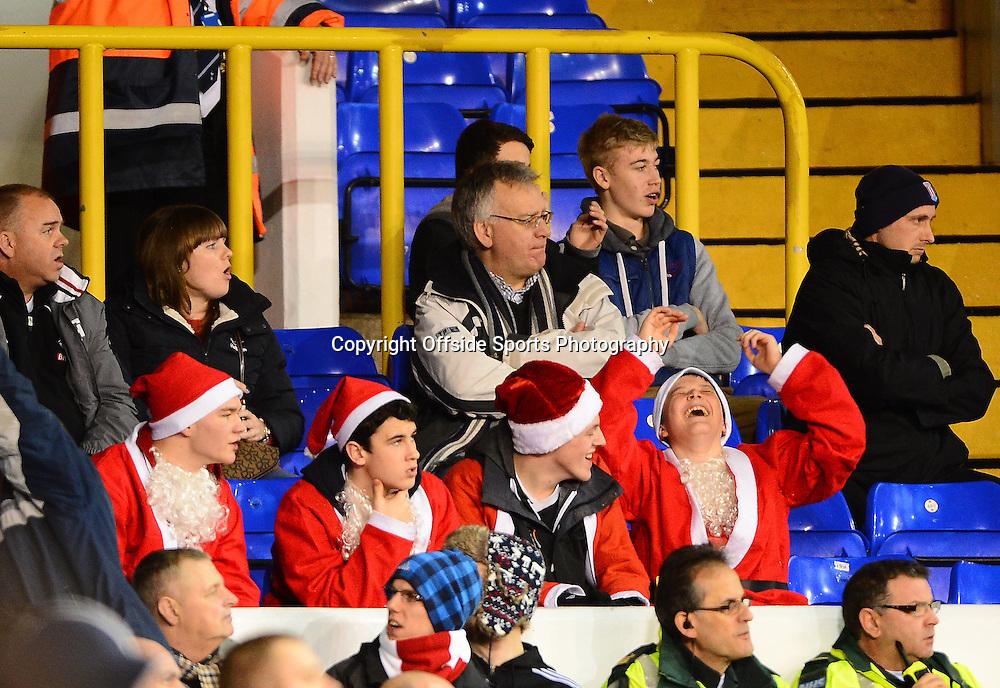 22nd December 2012 - Barclays Premier League - Tottenham Hotspur v Stoke City - Stoke City fans  dressed as Santa Claus joke during the game - Photo: Marc Atkins / Offside.