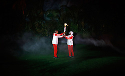 JAKARTA, Aug. 18, 2018  Torch bearers hand over the torch during the opening ceremony of the 18th Asian Games at the Gelora Bung Karno (GBK) Main Stadium in Jakarta, Indonesia, Aug. 18, 2018. (Credit Image: © Wang Lili/Xinhua via ZUMA Wire)