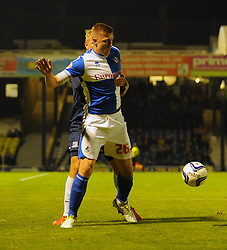 Bristol Rovers' Ryan Brunt holds off the Southend defender - Photo mandatory by-line: Seb Daly/JMP - Tel: Mobile: 07966 386802 27/09/2013 - SPORT - FOOTBALL - Roots Hall - Southend - Southend United V Bristol Rovers - Sky Bet League Two