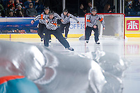 KELOWNA, CANADA - DECEMBER 5:  The referees enter the ice as the Swift Current Broncos visit the Kelowna Rockets on December 5, 2012 at Prospera Place in Kelowna, British Columbia, Canada (Photo by Marissa Baecker/Shoot the Breeze) *** Local Caption ***