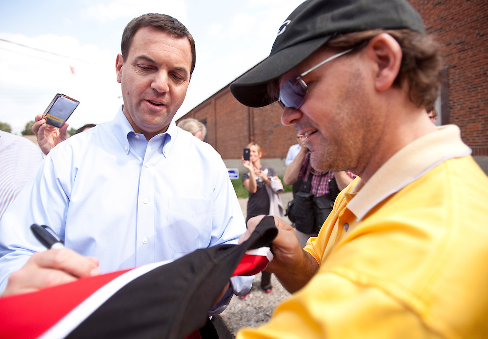 Ontario PC leader Tim Hudak signs a hockey jersey for his friend from high school and University, Jody Anderson, during a campaign stop in Chatham Ontario, Tuesday, September 13, 2011.<br /> THE CANADIAN PRESS/ Geoff Robins