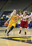 February 11 2013: Iowa Hawkeyes guard Jaime Printy (24) drives with the ball as Nebraska Cornhuskers guard Lindsey Moore (00) gives chase during the first half of the NCAA women's basketball game between the Nebraska Cornhuskers and the Iowa Hawkeyes at Carver-Hawkeye Arena in Iowa City, Iowa on Monday, February 11 2013.