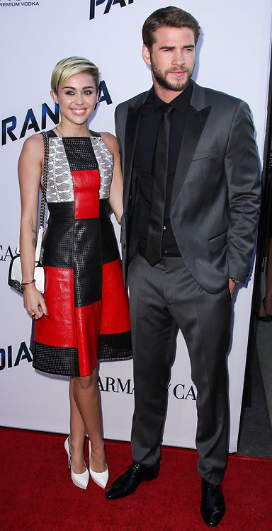 """(FILE) Miley Cyrus and Liam Hemsworth Donate $500,000 to Emergency Relief After Losing Home in California Wildfires. Miley Cyrus and Liam Hemsworth lost their home to a California wildfire, but the famous couple have their sights set on rebuilding not just their house but also their community. Cyrus and Hemsworth have donated $500,000 to The Malibu Foundation through Cyrus' charity, Happy Hippie, a representative said. The funds will be used for """"those in financial need, emergency relief assistance, community rebuilding , wildfire prevention and climate change resilience,"""" according to a statement. Earlier on Tuesday, Hemsworth shared a striking photo of their home's remains. BEVERLY HILLS, LOS ANGELES, CA, USA - MARCH 04: Singer Miley Cyrus and boyfriend/actor Liam Hemsworth arrive at the 2018 Vanity Fair Oscar Party held at the Wallis Annenberg Center for the Performing Arts on March 4, 2018 in Beverly Hills, Los Angeles, California, United States. 04 Mar 2018 Pictured: Miley Cyrus, Liam Hemsworth. Photo credit: Xavier Collin/Image Press Agency/MEGA TheMegaAgency.com +1 888 505 6342"""