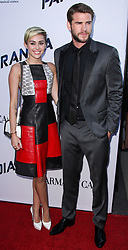 "(FILE) Miley Cyrus and Liam Hemsworth Donate $500,000 to Emergency Relief After Losing Home in California Wildfires. Miley Cyrus and Liam Hemsworth lost their home to a California wildfire, but the famous couple have their sights set on rebuilding not just their house but also their community. Cyrus and Hemsworth have donated $500,000 to The Malibu Foundation through Cyrus' charity, Happy Hippie, a representative said. The funds will be used for ""those in financial need, emergency relief assistance, community rebuilding , wildfire prevention and climate change resilience,"" according to a statement. Earlier on Tuesday, Hemsworth shared a striking photo of their home's remains. BEVERLY HILLS, LOS ANGELES, CA, USA - MARCH 04: Singer Miley Cyrus and boyfriend/actor Liam Hemsworth arrive at the 2018 Vanity Fair Oscar Party held at the Wallis Annenberg Center for the Performing Arts on March 4, 2018 in Beverly Hills, Los Angeles, California, United States. 04 Mar 2018 Pictured: Miley Cyrus, Liam Hemsworth. Photo credit: Xavier Collin/Image Press Agency/MEGA TheMegaAgency.com +1 888 505 6342"