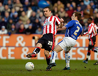 Photo: Leigh Quinnell.<br /> Leicester City v Southampton. The FA Cup. 28/01/2006. Southamptons David Prutton passes the ball while under presure from Leicesters Alan Maybury.