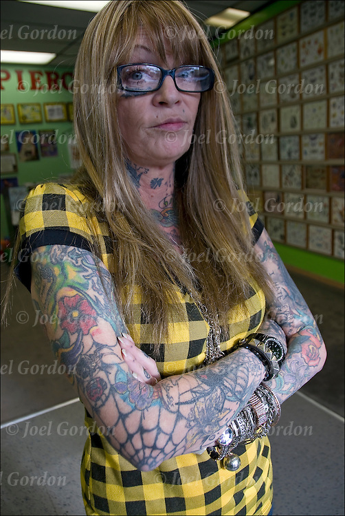 Portrait of Tattoo Artist, Tat2Terri inside of Lucky Lou's Tattoos, 1543 Kentucky &amp; Boardwalk, in Atlantic City, NJ. <br /> <br /> 90% of her body covered with tattoos. Terri has been getting tattoos for 30 years and doing them for 20.  <br /> <br /> When asked &quot;I get tattoos out of boredom&quot;.<br /> <br /> release  #2603