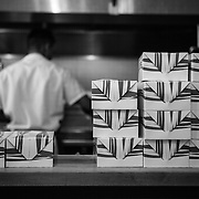 A shot of boxes and the kitchen at Federal Donuts in Philadelphia, PA.