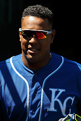 OAKLAND, CA - APRIL 17:  Salvador Perez #13 of the Kansas City Royals stands in the dugout before the game against the Oakland Athletics at the Oakland Coliseum on April 17, 2016 in Oakland, California.  The Oakland Athletics defeated the Kansas City Royals 3-2. (Photo by Jason O. Watson/Getty Images) *** Local Caption *** Salvador Perez