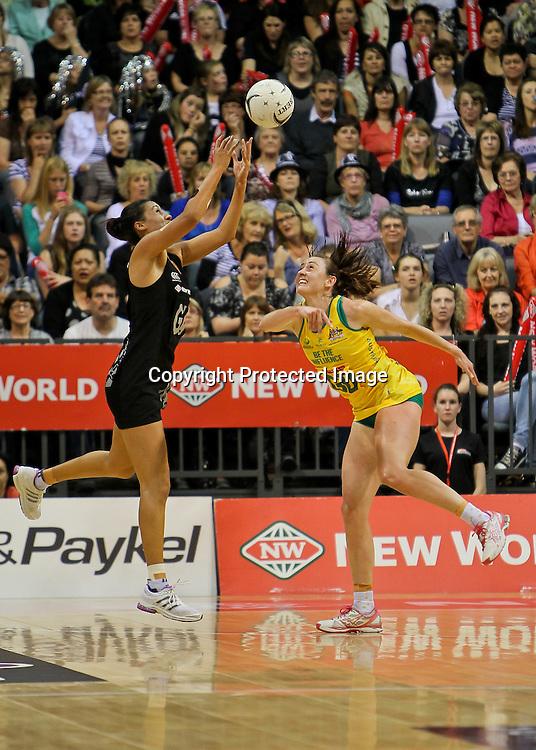 New Zealand's Maria Tutaia and Australia's Rebecca Bulley compete for the ball during the New World Quad Series - Silver Ferns v Australian Diamonds, 1 November 2012.  Photo:  Bruce Lim / www.photosport.co.nz