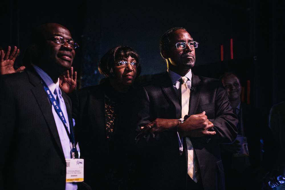 Dr. Ben Carson, right, a retired neurosurgeon, and his wife, Candy, wait backstage while he is introduced to speak during the final day of the Conservative Political Action Conference (CPAC) at the Gaylord National Resort & Convention Center in National Harbor, Md.