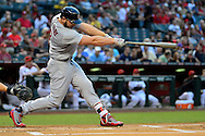 PHOENIX, ARIZONA - APRIL 27:  Matt Holliday #7 of the St. Louis Cardinals hits a ball resulting in a run scored on a fielding error in the first inning against the Arizona Diamondbacks at Chase Field on April 27, 2016 in Phoenix, Arizona.  (Photo by Jennifer Stewart/Getty Images)