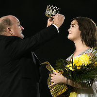 Itawamba Agricultural High School homecoming queen Sara Grace Boggs is crowned by her father, IAHS principal Trae Wiygul during halftime of Friday night's game against Aberdeen.